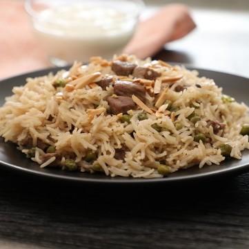 أرز باللحم والبازيلا بالفيديو
