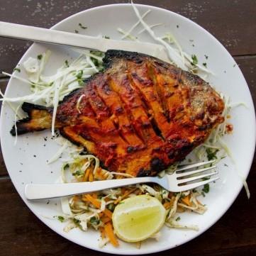 سمك مشوي بالتتبيلة الحارة